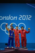 (From left) Silver medalist Oscar Albeiro Figueroa Mosquera of Colombia, gold medalist Kim Un Guk of North Korea and bronze medalist Irawan Eko Yuli of Indonesia pose at the award ceremony of the mens 62kg weightlifting event during the London 2012 O