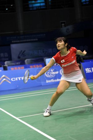 Photo for Japans Eriko Hirose returns a shot against Germanys Juliane Schenk during the womens single match at the BWF badminton Sudirman Cup 2011 in Qingdao, east Chinas Shandong province, 23 May 2011 - Royalty Free Image
