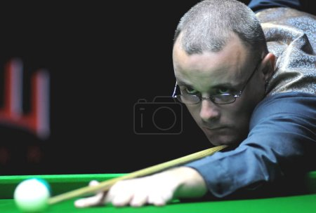 Photo for Martin Gould of England plays a shot against Mark Selb of England in the second round of the World Snooker Roewe Shanghai Masters 2010 in Shanghai, China, September 9, 2010 - Royalty Free Image