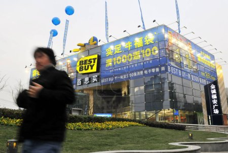 Photo for A man walks past a Best Buy store in Shanghai, China, January 26, 2009 - Royalty Free Image