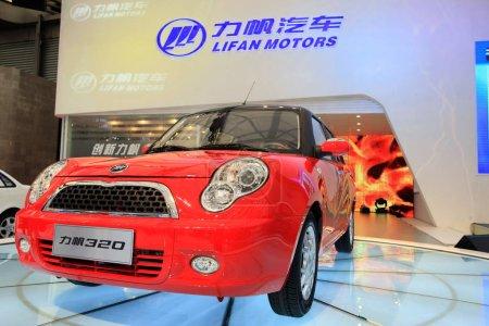 A Lifan 320 minicar is