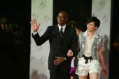 Hong Kong singer Gigi Leung, right, goes with Olympic mens 400m gold medal winner and Chairman of the Laureus World Sports Academy Edwin Moses, left, at the 2007 China Top Ten Benefiting Laureus Sports For Good award ceremony in Changsha, Hunan provi