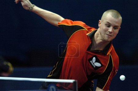 Photo for Michael Maze of Denmark returns the ball against a player of Chinese Taipei during the World Team Table Tennis Championships in Guangzhou, south Chinas Guangdong province, February 28, 2008. Taipei defeated Denmark 3-1. - Royalty Free Image