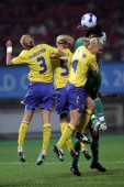 (From front left) Stina Segerstrom, Caroline Seger and Hanna Marklund of Sweden compete two Nigerian players during a Group B match of the 2007 FIFA Womens World Cup in Chengdu, southwest Chinas Sichuan province 11 September 2007. Sweden drew with Ni