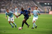 Samuel Etoo Fils of Inter Milan FC, center, breaks through Roberto Baronio, left, and Mauro Matias Zarate, right, of Lazio FC in the final of the Italian Super Cup at the National Stadium, known as the Birds Nest, in Beijing, China, Saturday, 8 Augus