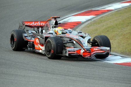 Photo for British F1 driver Lewis Hamilton of McLaren F1 Team competes during the Formula One Chinese Grand Prix 2008 at the Shanghai International Circuit in Shanghai, China, Sunday, 19 October 2008 - Royalty Free Image