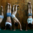Four Chinese boys practise handstand during a trai...