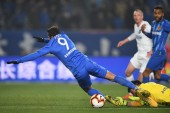 Italian-Brazilian football player Eder Citadin Martins, simply known as Eder, of Jiangsu Suning F.C., left, is challenged by Du Jia of Tianjin TEDA F.C. in their 1st round match during the 2019 Chinese Football Association Super League (CSL) in Nanji