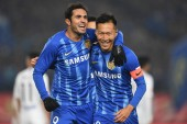 Italian-Brazilian football player Eder Citadin Martins, simply known as Eder, left, and Wu Xi of Jiangsu Suning F.C. celebrate after scoring a goal against Tianjin TEDA F.C. in their 1st round match during the 2019 Chinese Football Association Super