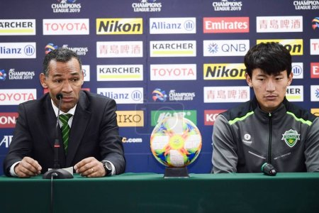 Photo for Head coach Jose Morais, left, and Han Kyo-won of Jeonbuk Hyundai Motors F.C. attend a press conference after the group G match between China's Beijing Sinobo Guoan F.C. and South Korea's Jeonbuk Hyundai Motors F.C. during the 2019 AFC Champions Leagu - Royalty Free Image