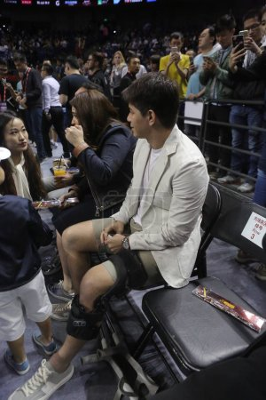 Photo for Argentine football star Dario Conca watches the basketball match between Houston Rockets and New Orleans Pelicans during the NBA China Games in Shanghai, China, 9 October 2016. - Royalty Free Image