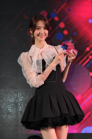 Photo for Lim Yoon-a of South Korean idol group Girls' Generation poses with her trophy for the Asian Fashion Award during the 2016 CeCi Beauty Awards ceremony in Shanghai, China, 14 December 2016. - Royalty Free Image