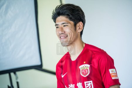 Photo for **EXCLUSIVE**Lv Wenjun of Shanghai SIPG F.C. poses during the filming session of official portraits for the 2019 Chinese Football Association Super League, in Shanghai, China, 25 February 2019. - Royalty Free Image