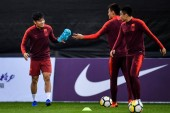 Players of Chinese national men's football team take part in a training session for the opening match against Thailand national men's football team during the 2019 GREE China Cup International Football Championship in Nanning city, south China's Guan