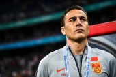 Head coach Fabio Cannavaro of Chinese national football team reacts as he watches his players competing against Thailand national men's football team in their opening match during the 2019 China Cup International Football Championship in Nanning city