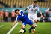 Otabek Shukurov of Uzbekistan, left, challenges Matias Vecino of Uruguay during their semi-final match of the 2019 China Cup International Football Championship in Nanning city, south China's Guangxi Zhuang Autonomous Region, 21 March 2019.