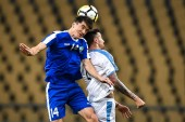 Eldor Shomurodov of Uzbekistan, left, challenges Matias Vecino of Uruguay during their semi-final match of the 2019 China Cup International Football Championship in Nanning city, south China's Guangxi Zhuang Autonomous Region, 21 March 2019.