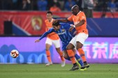 Cameroonian football player Stephane Mbia Etoundi of Wuhan Zall F.C., right, challenges Italian-Brazilian football player Eder Citadin Martins, simply known as Eder, of Jiangsu Suning F.C. in their 3rd round match during the 2019 Chinese Football Ass