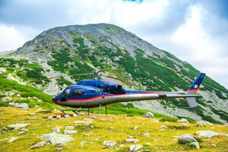Photo for View of the mountains and the mountain peaks of the swiss alps and helicopter - Royalty Free Image