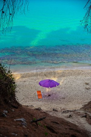 Photo for Beach chair and umbrella on the sandy coast of the sea - Royalty Free Image