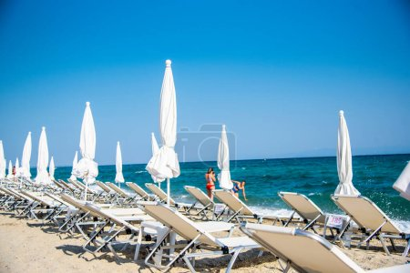Photo for Beautiful beach chairs and umbrellas on the sandy tropical sea - Royalty Free Image