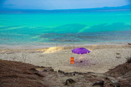 Photo for Beach chair and umbrella on the sandy tropical sea - Royalty Free Image
