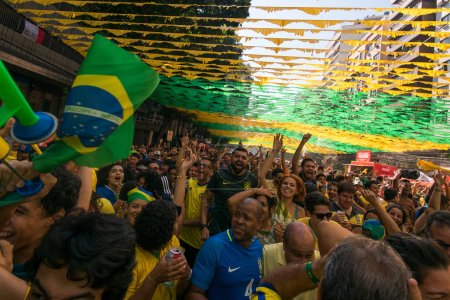 RIO DE JANEIRO, BRAZIL - JUNE 22, 2018: Brazilian fans celebrating victory against Costa Rica at 2018 FIFA World Cup