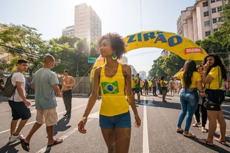 Rio de Janeiro, Brazil - June 22, 2018: Young Brazilian woman coming to support national football team during 2018 FIFA World Cup