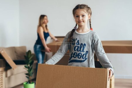 Photo for Family with cardboard boxes. Moving into new home. - Royalty Free Image