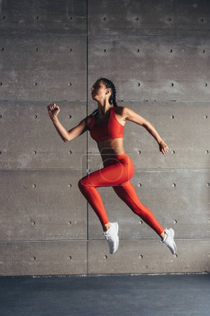 Photo for Side view fit woman doing cardio training - Royalty Free Image