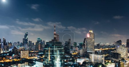 City at night with urban buildings. Aerial view.