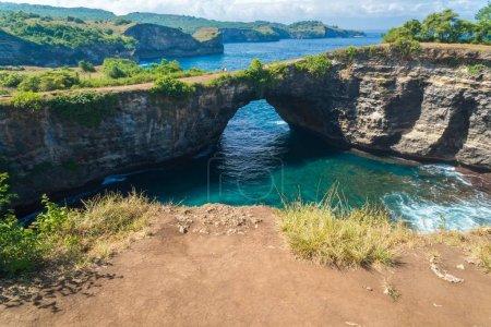 Rock coastline Stone arch over