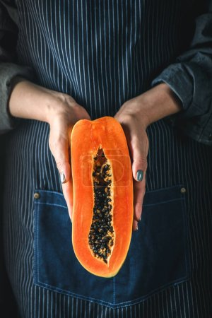 Papaya exotic fruit from Asia. One half of tropica...