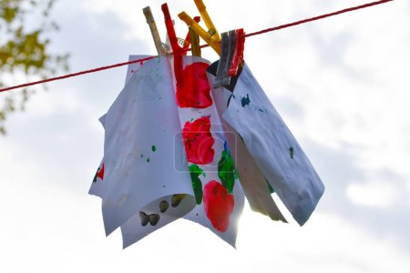 Child activity, colorful hanging on the rope with ...