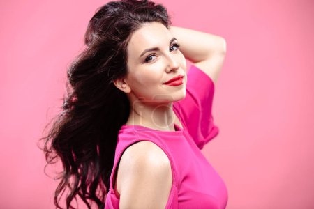 Photo for Beauty portrait of young brunette woman on a bright pink background. Model with make-up and hairstyle, closeup, fashion glamour photo - Royalty Free Image