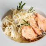 Italian Tagliatelle Pasta with fried Salmon Fillet...