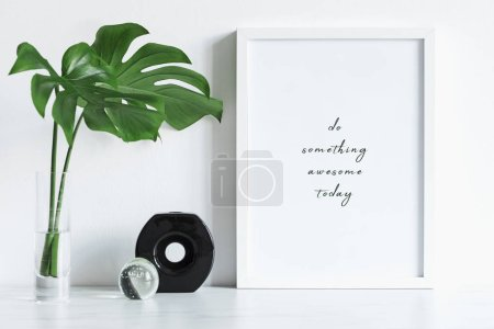 Photo for Minimalistic frame with inspirational phrase and green leaves in vase - Royalty Free Image