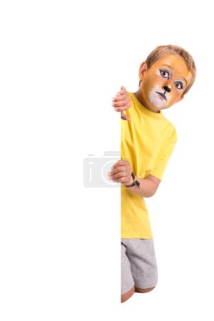 Photo for Boy with animal face-paint over a white board isolated in white - Royalty Free Image