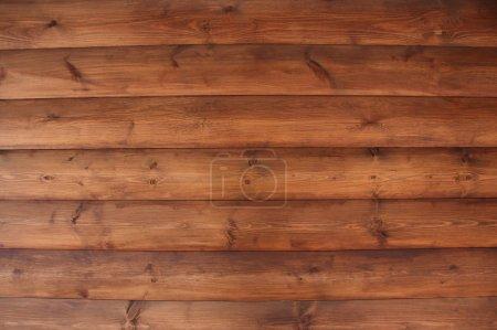 Photo pour Mur brun d'une maison en bois - image libre de droit