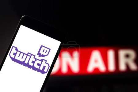 Photo for April 22, 2019, Brazil. Twitch TV logo on Android mobile device. Twitch is a streaming site focused on streaming video games, including live or on-demand playthroughs. - Royalty Free Image