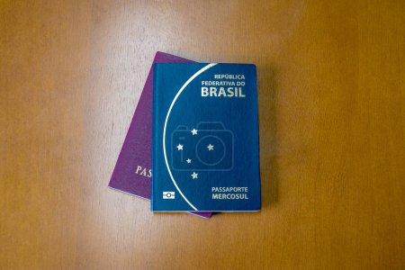 Brazilian and european passports on wooden backgro...