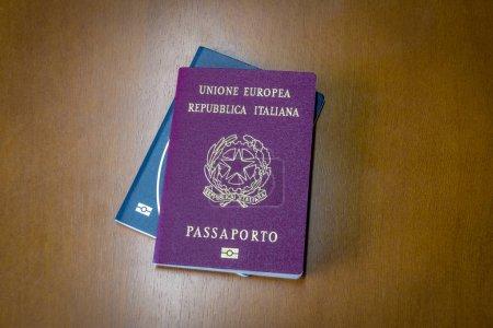 Italian and brazilian passports on wooden backgrou...