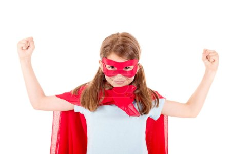 little girl pretending to be a superhero isolated on white background