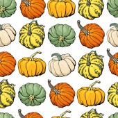 Seamless pattern with colored pumpkins on white background simple picture with pumpkins to holiday halloween abstract wallpaper with vegetables