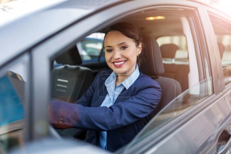 Photo for Businesswoman driving a car - Royalty Free Image
