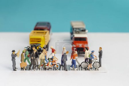 Photo for Top view of miniature toys of crowd walking on zebra crossing with vehicles stopped concept. - Royalty Free Image