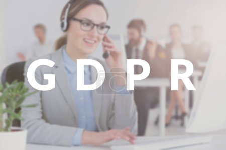 Call center employee talking to customers about the personal information her company collects. Blurred photo with white GDPR banner