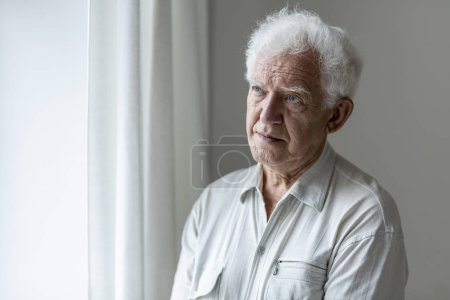 Photo for Elderly man looking away and thinking - Royalty Free Image