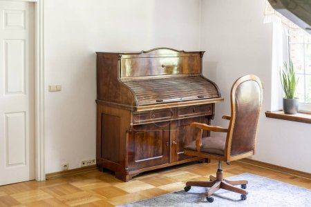 Classic piano and chair on wheels in an antique room interior. Real photo