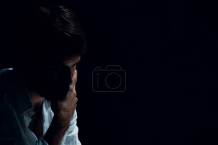 Photo for Portrait of handsome man with problems, copy space on the black background - Royalty Free Image